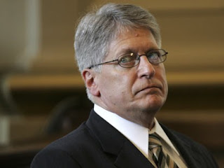 Nifong listens as rules violations are being announced during his NC State Bar trial in Raleigh on Sat., June 16, 2007