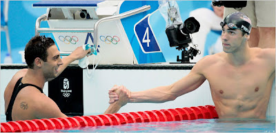 Michael Phelps and 'Mike' Cavic shake hands after race, photo