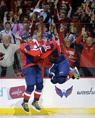 Ovechkin jumps into the arms of fellow countrymen Sergei Fedorov (91) after scoring his third goal of the game