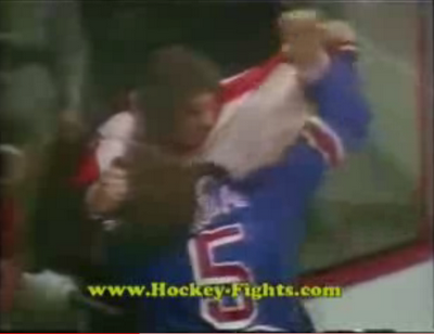 Dave Schultz pulling Dale Rolfe's hair