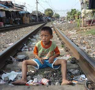 [Image: child+sitting+on+tracks.jpg]