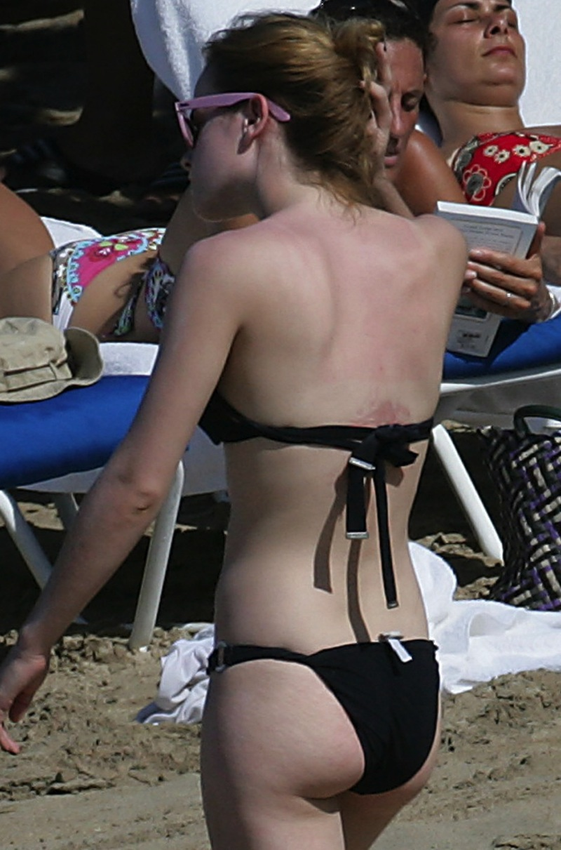 topless girl straddling chair