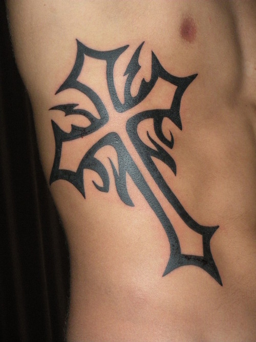 Black ink Cross Tattoo on Guys Ribs