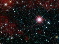 This infrared snapshot of a region in the constellation Carina near the Milky Way was taken shortly after NASA's Wide-field Infrared Survey Explorer (WISE) ejected its cover