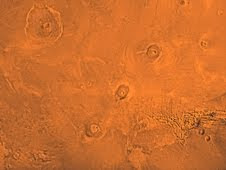 The Tharsis region of Mars, including the three volcanoes of Tharsis Montes (Arsia, Pavonis and Ascraeus Mons), as well as Olympic Mons in the upper left corner.