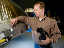 Rob Black, senior applications engineer with Shape Fidelity Inc., of Huntsville, Ala., a contractor with the Ares I Upper Stage team, sets up for photogrammetry process.