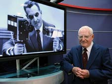 Stan Lebar next to an image of him with the lunar camera.