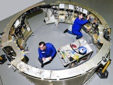 Gary Postlethwait, right, and Bert Priest, test technicians with ATK Aerospace Systems of Magna, Utah, make final preparations for testing inside the avionics mounting structure. Credit: ATK