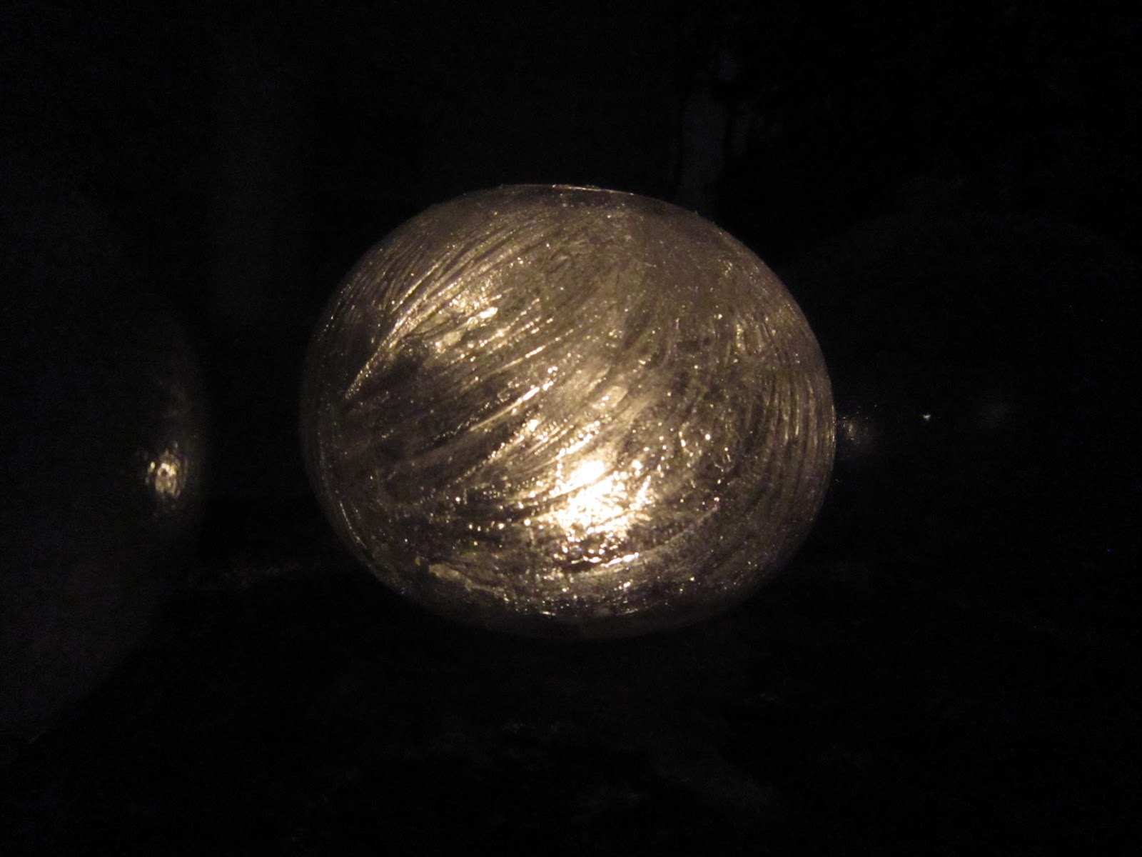 Chuck does art diy water balloon ice candle holders for Making luminaries