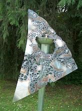 Fliegendes Dreieck an Oellicht