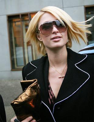 Paris Hilton in Formal with Stylish Handbags