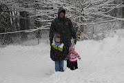 Stacy and the kids in the snow,