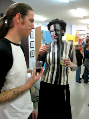 Oy of Stay True Tattoo chatting with one of the models.