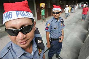 Police officers wearing Santa hats