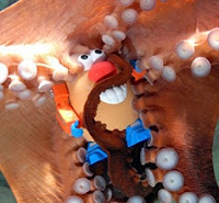 Louis the octopus hanging on to a potato head