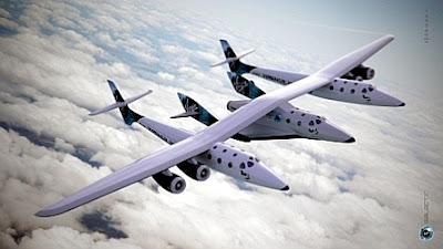 SpaceShipTwo is carried between the two fuselages of White Knight II