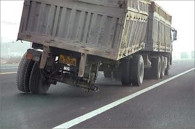 Truck missing rear wheel