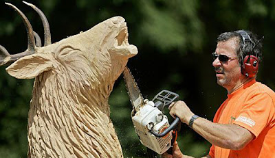 Using chainsaw to sculpt wood