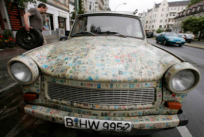 Car covered with thousands of stamps