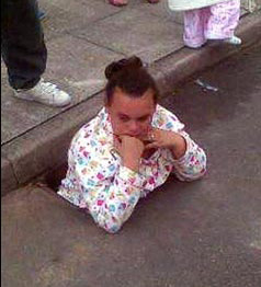 Chanelle Edwards stuck in a drain