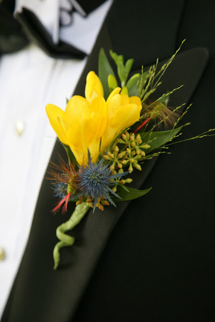 Boutonniere created by Belle Fiori includes fly fishing lures