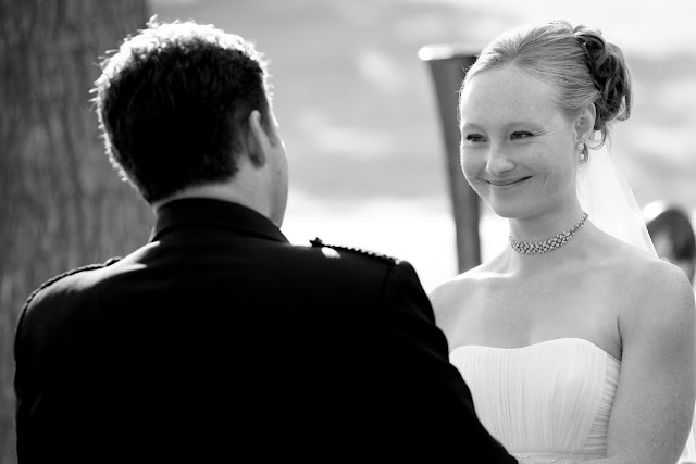 Bride smiling at groom as they exchange wedding vows