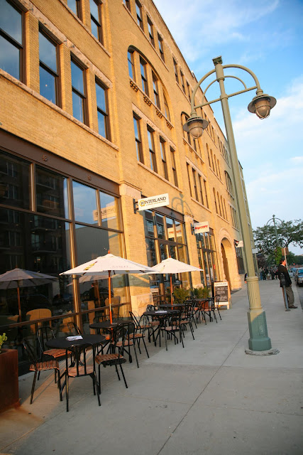 Third Ward restaurant Hinterland Erie Street Gastropub exterior at sunset