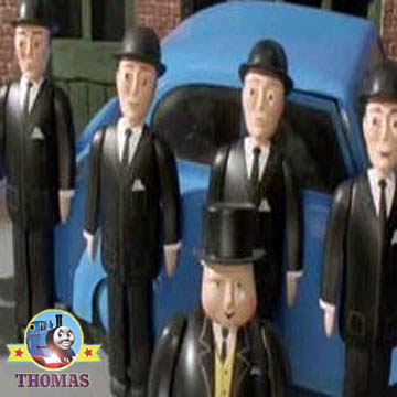 Gentlemen of the isle of Sodor railway board by the fat controllers car seeing Crane Harvey train