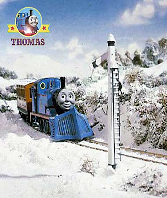 Thomas the train has stopping opposite a meadow for a red railway signal seeing Terence and the Snow