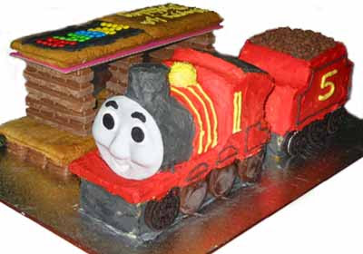 Island of Sodor cake with Thomas and friends James the red engine standing at the railway station