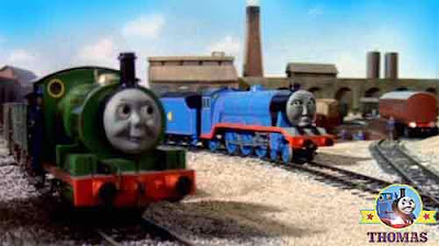 Thomas the train Percy the small engine and Gordon the tank engine waiting for Pullman special coach