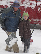Grandpa and Peter shoveling snow
