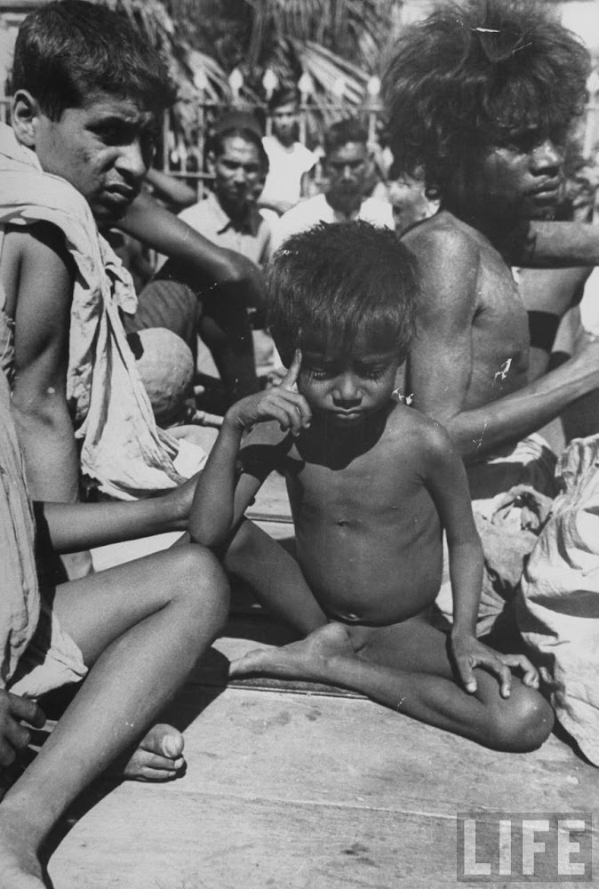 Starving families sitting in the hot scortching sun