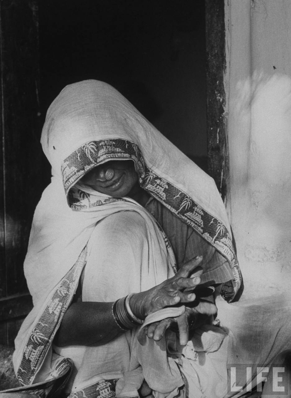 Indian farmer's wife making chupattis - 1962