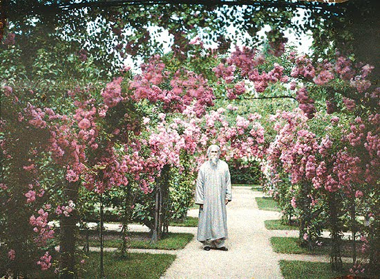 Colour Photo of Rabindranath Tagore in Albert Kahn's rose garden, Paris, 1921
