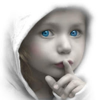 blue eyed child holding finger over lips