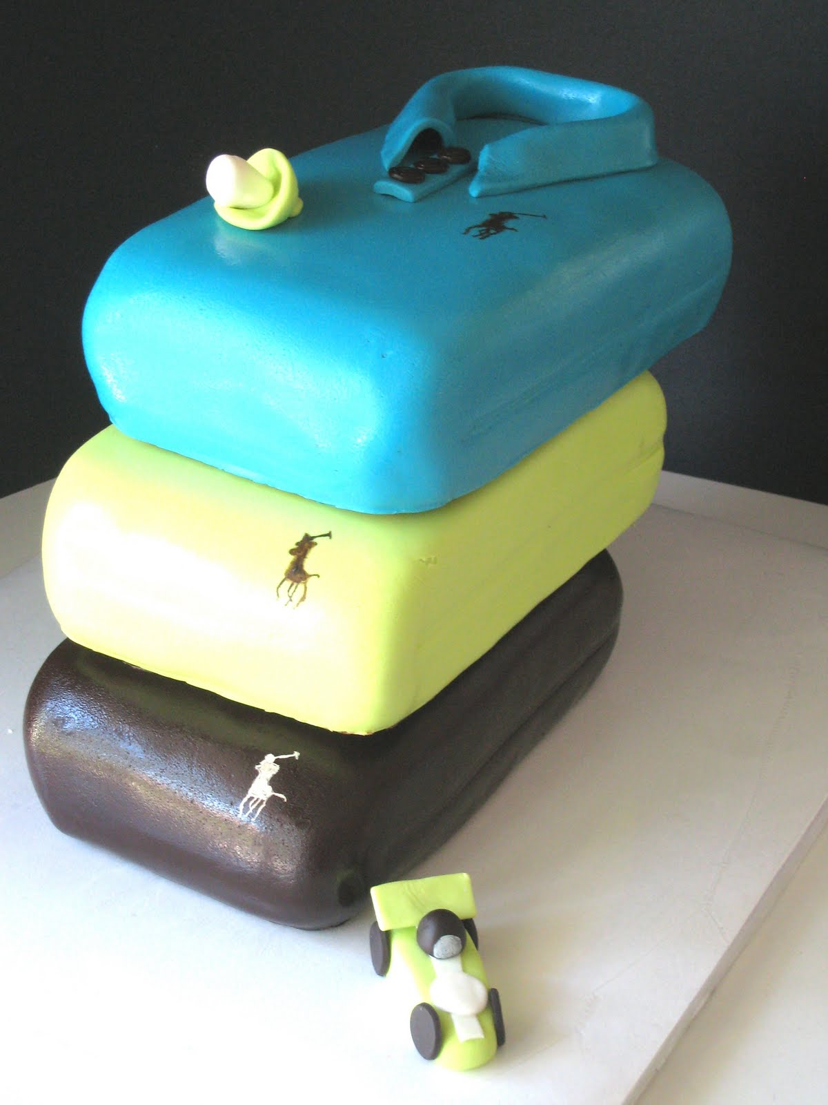 ... Green And Brown), With The Polo Logo On Each Shirt. Accompanying The  Shirts Were Fondant Decorations Of A Toy Car And A Pacifier   Adorable  Touches!