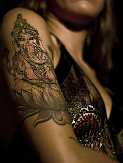 Ganesha Tattoo on up arm of girl
