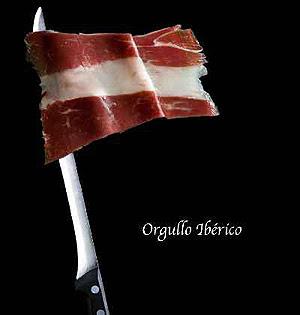 bandera española grasa entre jamón ensartada en cuchillo jamonero