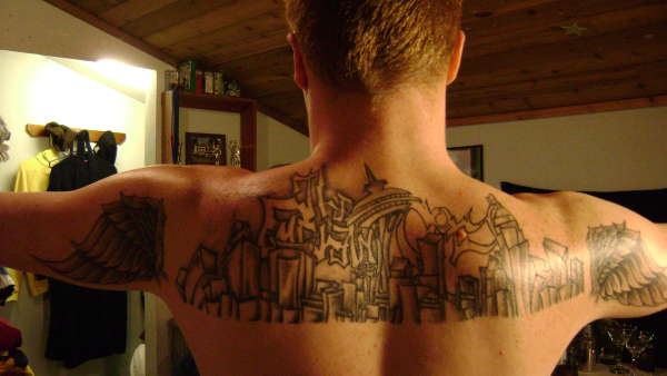I love the idea of a getting a tattoo with the Seattle skyline.