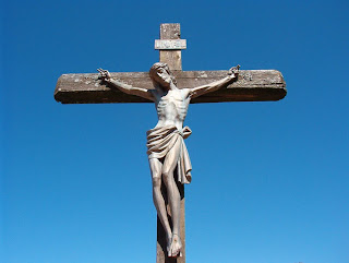 Jesus hanging on the wooden Cross with sky background photos for powerpoint(ppt) for Christian download for free