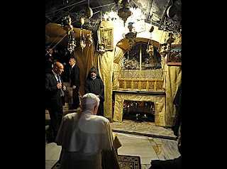Pope Benedict XVI at grotto at the Church of the Nativity in Bethlehem the place of the Virgin Mary gave birth to Jesus hd(hq) photo