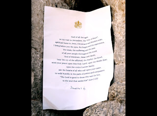 The note left by Pope Benedict XVI at the Western Wall and with pope sign on the note letter paper pic