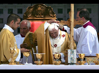 Pope Benedict XVI is adjusting  his skullcap at Manger Square outside the Church of the Nativity in Bethlehem celebration event pic