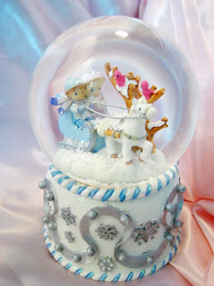 Beautiful white and skyblue Christmas snow globe and boy riding horse photo