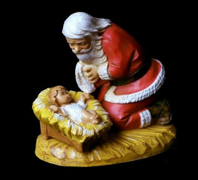 Santa Praying at child Jesus stable(manger) on bowing on his knees(kneeling) free download Christian Christmas pictures