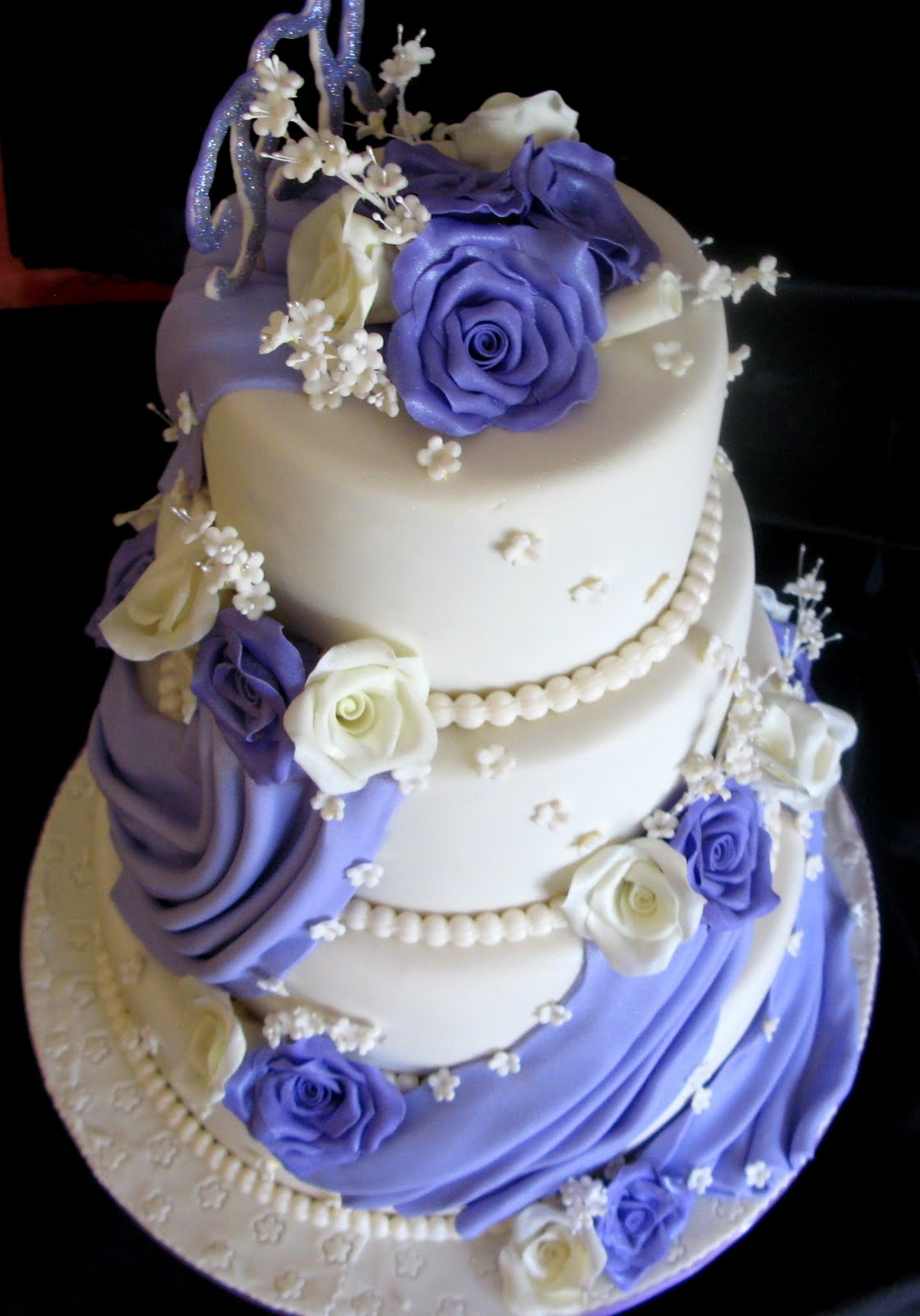 Three Tier White Wedding Cake With Roses