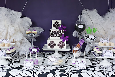 i was invited to design a new years eve theme dessert table and heres what i came up with i wanted bold but elegant the black and purple seemed like the