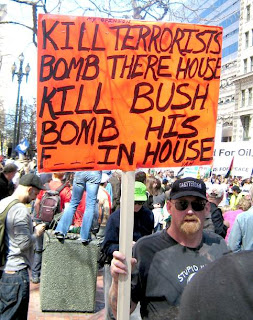 protester with a sign saying Kill Bush and advocating that the White House be bombed, at the March 18 2007 anti-war rally in San Francisco