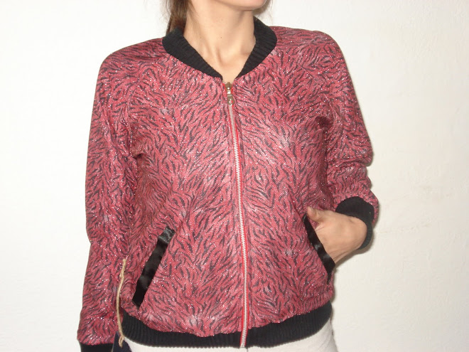 campera lurex animal print